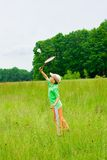 Badminton. Cute kid playing badminton outdoors Stock Images