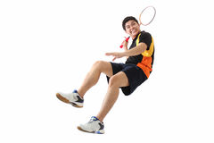 Badminton in action. Young male badminton player in action.Isolated in plain background Stock Photos
