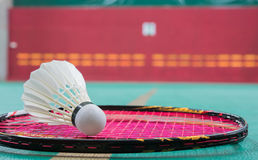 Badminton. Ball & x28;shuttlecock& x29; and racket on court floor. Vivid tone. White color  ball. Two  racket.  ball with selective focus Stock Photography