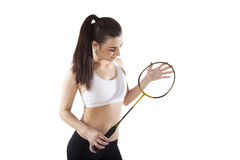 Badminton. Beautiful girl holding badminton racket on white background. Active healthy lifestyle Stock Images