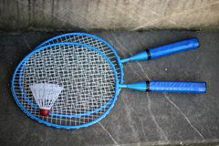 Badminton. Blue badminton racquets with shuttlecock Royalty Free Stock Image
