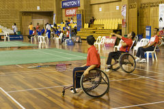 Badminton da cadeira de rodas dos homens Imagens de Stock