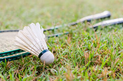 Badminton on the grass. The shuttle and badminton racket on the grass stock image