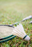 Badminton on the grass. The shuttle and badminton racket on the grass royalty free stock photo