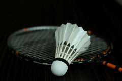 Badminton and new shuttelcock. Badminton racket and shuttlecock isolated on a black background Royalty Free Stock Images