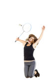 Badminton player in action holding racket to catch shuttlecock Stock Photo