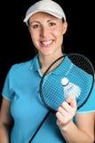 Badminton player holding badminton racket and shuttlecock Stock Photos