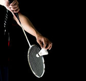 Badminton player holding racket and shuttlecock. In game service Royalty Free Stock Images
