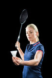 Badminton player holding a racquet ready to serve Royalty Free Stock Photos
