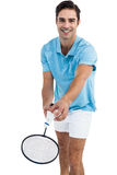 Badminton player holding a racquet ready to serve Stock Photography