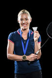 Badminton player posing with gold medal around his neck Stock Image