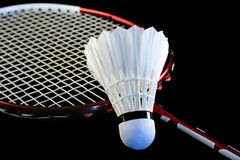 Badminton racket. And shuttlecock isolated on a black background Stock Photos