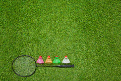 Badminton racket with color shuttlecocks Royalty Free Stock Photos
