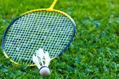 Badminton racket on grass. And Shuttlecock royalty free stock images