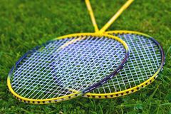 Badminton racket on grass. And Shuttlecock stock image