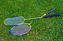 Badminton racket on grass. And Shuttlecock stock images