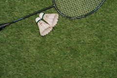 Badminton racket on the green , top view royalty free stock photography