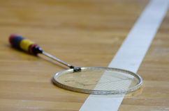 Badminton racket over white line Stock Image