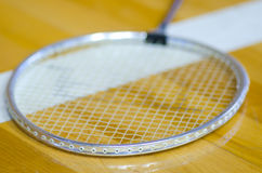 Badminton racket over white line Royalty Free Stock Photography