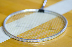 Badminton racket over white line Royalty Free Stock Photos