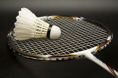 Badminton racket and shuttlecock. In a black background Stock Images
