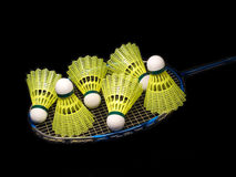 Badminton racket wit yellow shuttlecock isolat. Badminton racket wit six yellow shuttlecock isolated on black Stock Photography