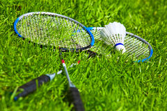 Badminton rackets. On green grass Royalty Free Stock Photography