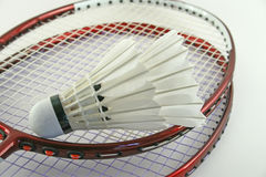 Badminton rackets. Badminton racket and shuttlecock on a white background Stock Images