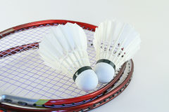 Badminton rackets. Feather shuttlecocks and badminton rackets isolated on a white background Royalty Free Stock Images