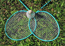 Badminton rackets in grass Stock Photography