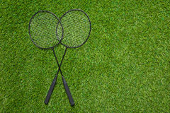 Badminton rackets lying on the grass Stock Images