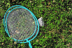 Badminton rackets and shuttle. In the grass Royalty Free Stock Photo