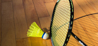 Badminton rackets. And shuttlecock on court Royalty Free Stock Photography