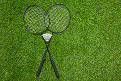Badminton rackets with shuttlecock on the grass Royalty Free Stock Photography