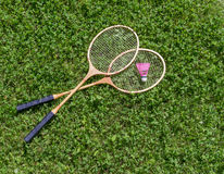 Badminton rackets and shuttlecock on grass Stock Images