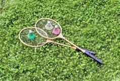 Badminton rackets and shuttlecocks on grass Stock Image