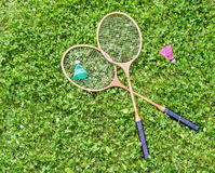 Badminton rackets and shuttlecocks on grass Stock Photos