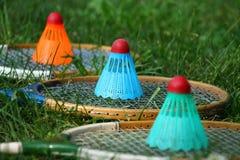 Badminton rackets and shuttlecocks on grass. In the garden Stock Photos