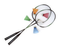 Badminton racquets with color shuttlecocks Stock Images