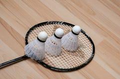 Badminton raquet. On wooden floor stock photography
