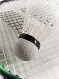 Badminton shuttlecock. On the racquet closeup white background Stock Photo