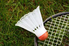 Badminton shuttlecock. And racket on green grass; in horizontal orientation Stock Photo