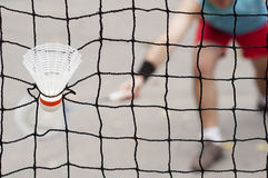 Badminton shuttlecock. Captive in the net Stock Photography