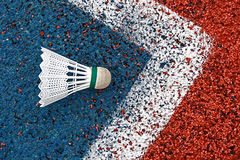 Badminton shuttlecock-5. Badminton colored shuttlecock placed in the corner of a synthetic field Stock Photography