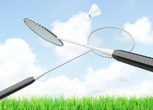 Badminton shuttlecock and rackets located on a background of sky Royalty Free Stock Image