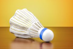 Badminton shuttlecock on the wooden table. 3D rendering. Badminton shuttlecock on the wooden table. 3D Royalty Free Stock Photos