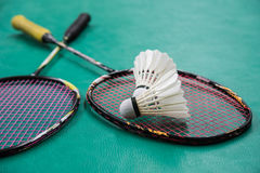 Badminton. Two shuttlecocks and badminton racket Stock Image