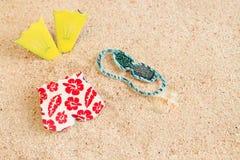 Badpak op het strand stock afbeelding