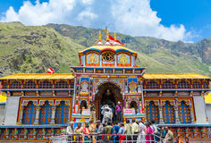 Badrinath Temple, Uttarakhand, India. BADRINATH, UTTARAKHAND, INDIA - CIRCA MAY 2013: Hindu pilgrims ascend the steps to the temple of Badri-Narayana in the royalty free stock images