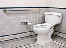 badrumhandikapp Arkivbild